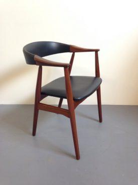 Danish teak armchair with carved armrests