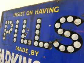 Pills Enamel Sign